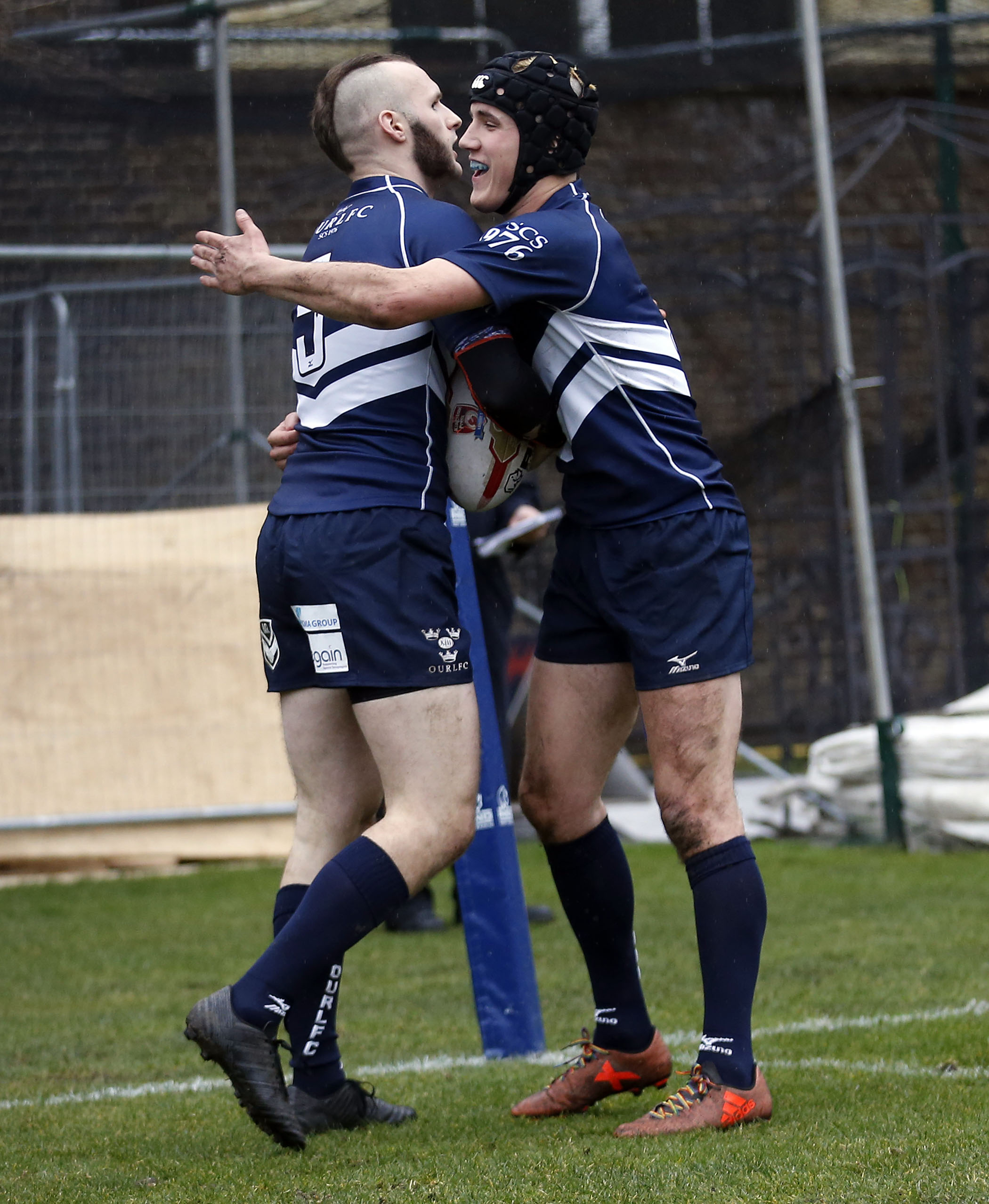 John Wylde (L) congratulated on his try for Oxford the RCMA Varsity Rugby League game between Cambridge University and Oxford University at the HAC Ground, Moorgate, London on Fri Mar 9, 2018