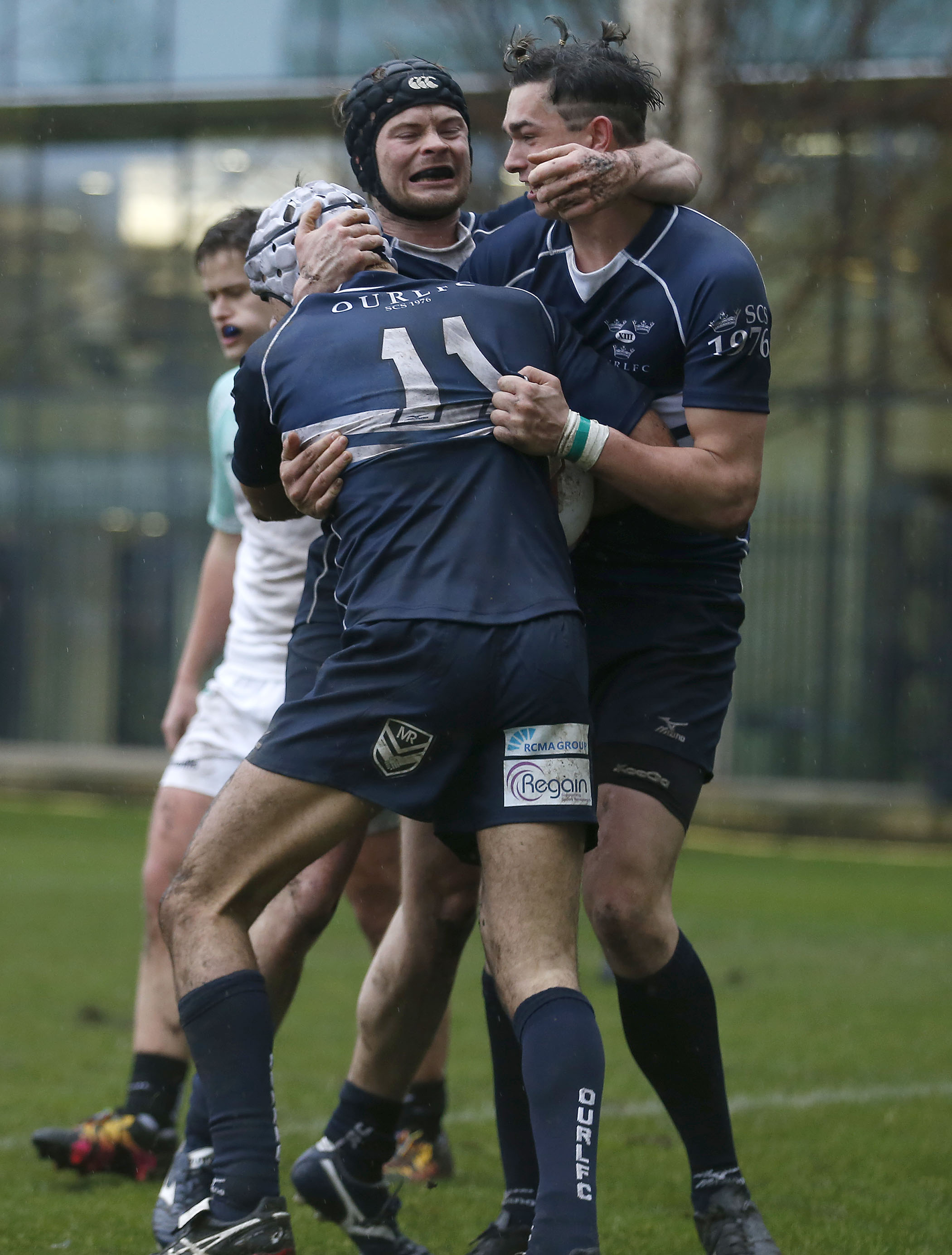 Marco Hiscox (no 11) is mobbed after his try for Oxford during the RCMA Varsity Rugby League game between Cambridge University and Oxford University at the HAC Ground, Moorgate, London on Fri Mar 9, 2018