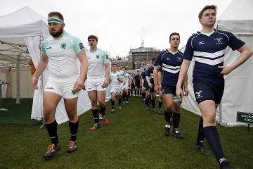 Teams enter the field during the RCMA Varsity Rugby League game between Cambridge University and Oxford University at the HAC Ground, Moorgate, London on Fri Mar 9, 2018
