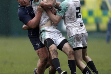 Craig Winfield of Cambridge is tackled by Sven Kerneis (L) during the RCMA Varsity Rugby League game between Cambridge University and Oxford University at the HAC Ground, Moorgate, London on Fri Mar 9, 2018